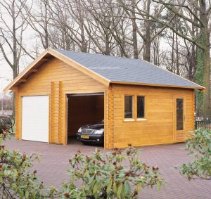 Woodpro log cabin system garage G7 with an apex roof.