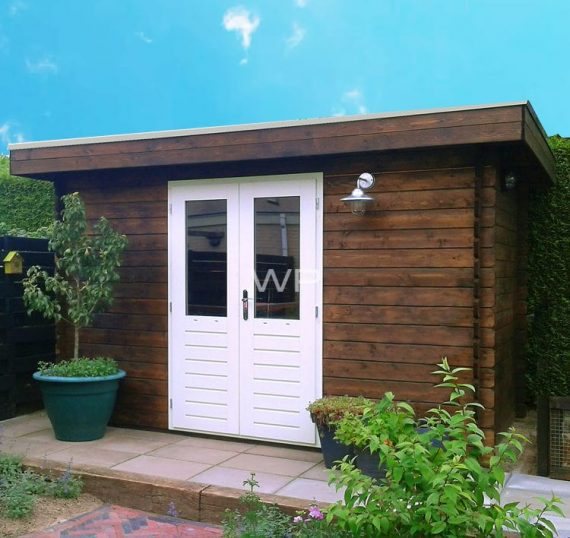 Brown wooden summer house with a flat roof